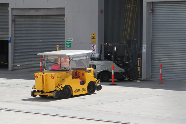NITEQ model RRM-500 hi-rail shunter moving between roads
