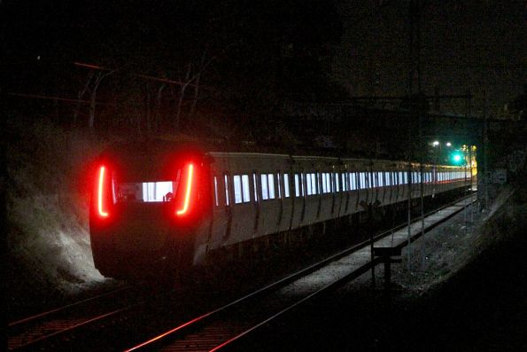 HCMT set 3 trails the 14-car train out of Northcote on the up