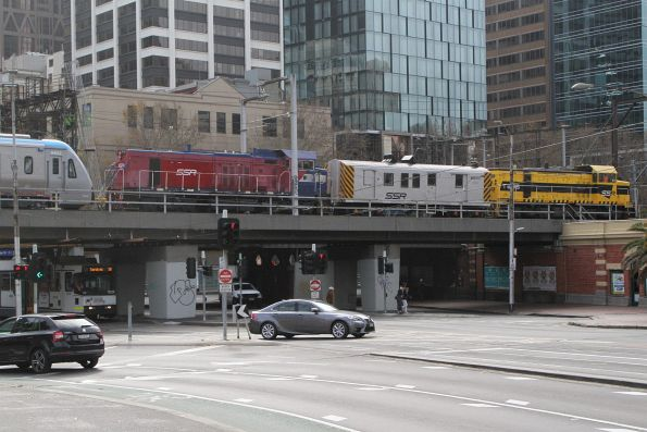 T385 leads P18, power van BVDY51 and HCMT set 2 over the Flinders Street Viaduct