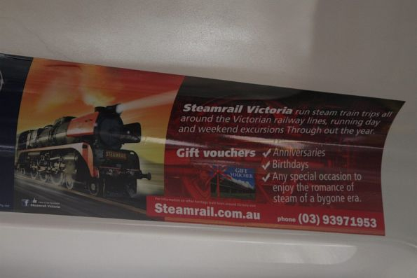 Advertisement for Steamrail Victoria onboard a Comeng train