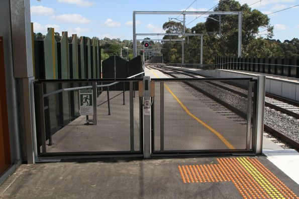 Emergency exit gates beside the tracks at the down end of Rosanna station