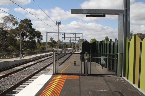 Emergency exit gates beside the tracks at the up end of Rosanna station