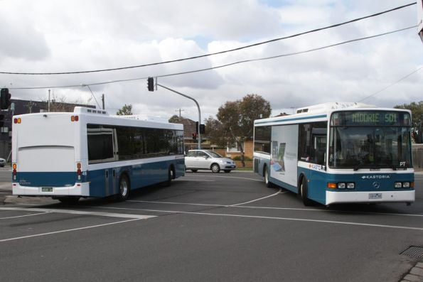 Kastoria Bus Lines buses #49 rego BS00AX and rego 1414AO cross paths at Essendon station