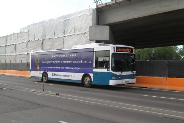 Kastoria bus #43 9272AO on a route 462 service passes level crossing removal works at Melton Highway, Sydenham