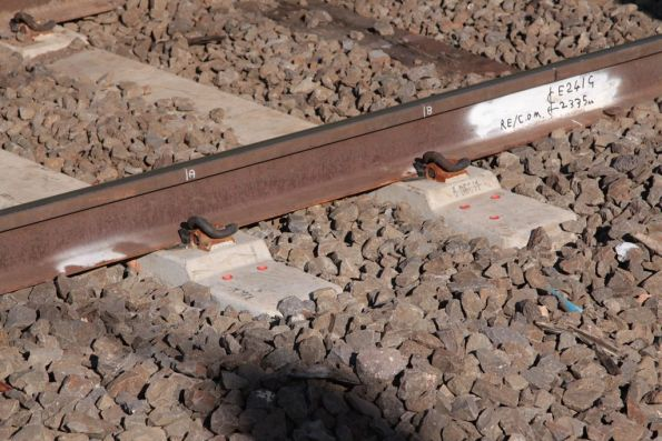 Pair of concrete sleepers with mounting holes for a train stop