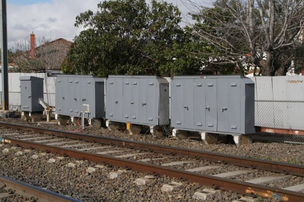VR-era relay boxes beside the tracks near Essendon