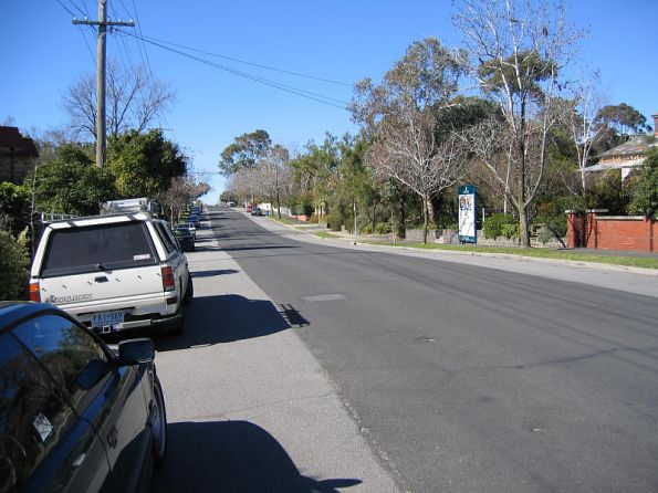 Dip in the road in Hawthorn Grove where the rail line crossed, looking east, Barker Station to the left