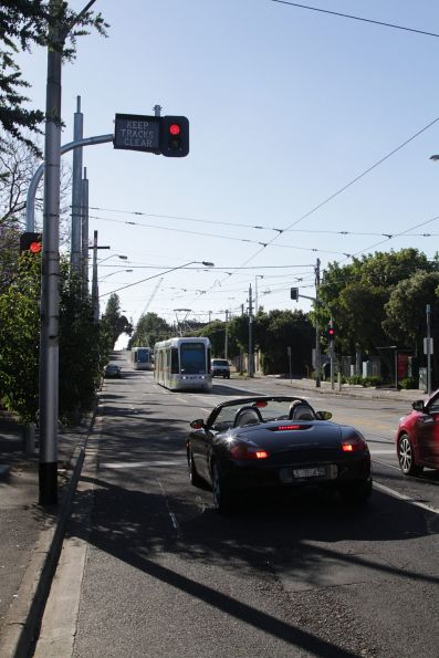 Two aspect traffic signals and illuminated 'Keep tracks clear' signs allow trams to safely shunt into Kew Depot from Barkers Road