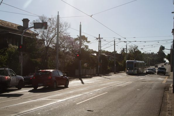 Road traffic stopped, with a tram ready to shunt into Kew Depot from the up track on Barkers Road