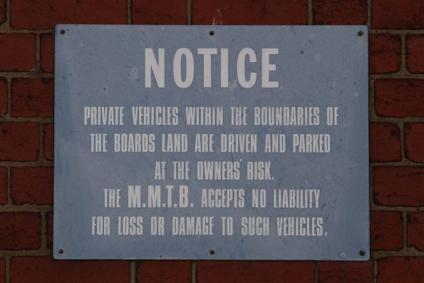 MMTB-era 'private vehicles are parked at their own risk' sign at Kew Depot