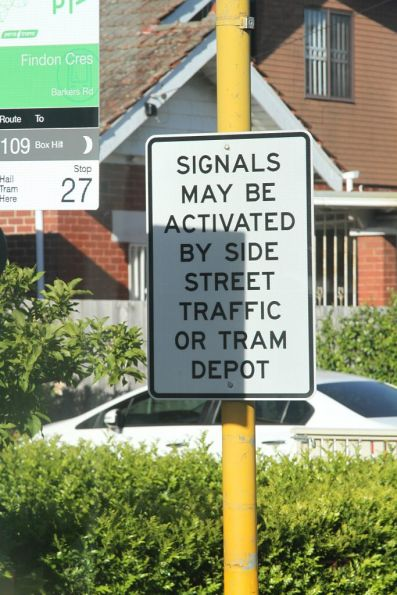 'Signals may be activated by side street traffic or tram depot' notice at Barkers Road and Findon Crescent