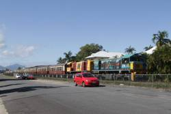 Locomotives 1734 and 1764 lead the 9.30am train through the Cairns suburbs