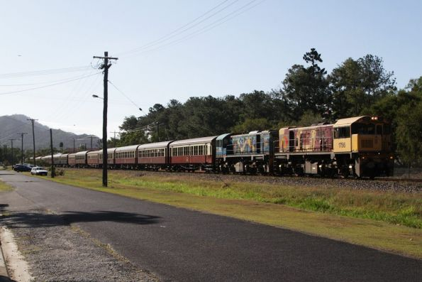 First train out is the first one home - locomotives 1756 and 1771 pass through the Cairns suburbs on their way home