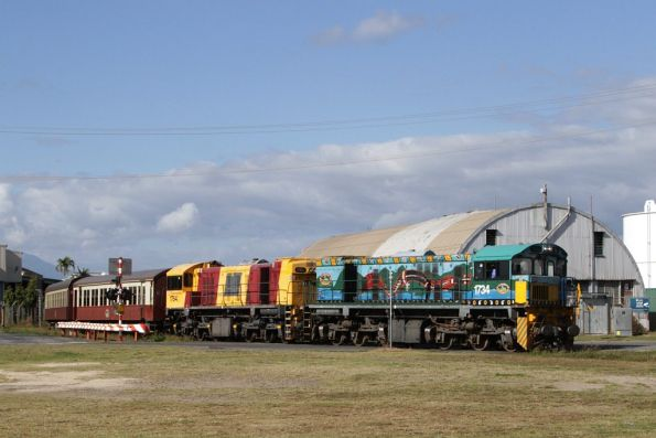 Locomotives 1734 and 1764 pass the oil terminals in southern Cairns on the empty car move from Portsmith Yard