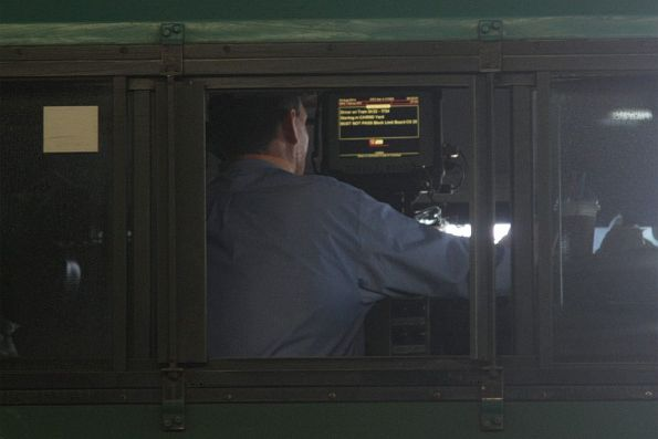 Train driver enters trip details into the DTC console inside the cab