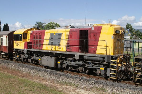 Locomotive 1764 with the old QR logo pointed out, and the new Queensland Rail logo on the cab side