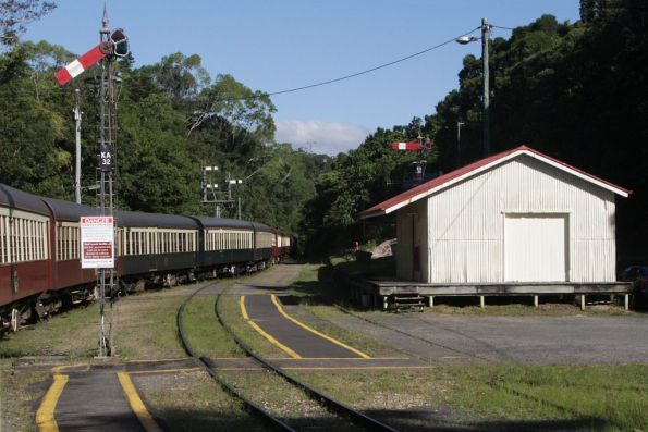 Departing Kuranda station, with the goods shed in the background