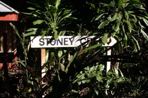 'Stony Creek' signboard being covered by the rainforest