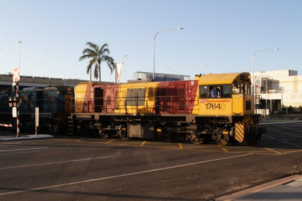 QR 1764 leads the empty carriages out of Cairns station