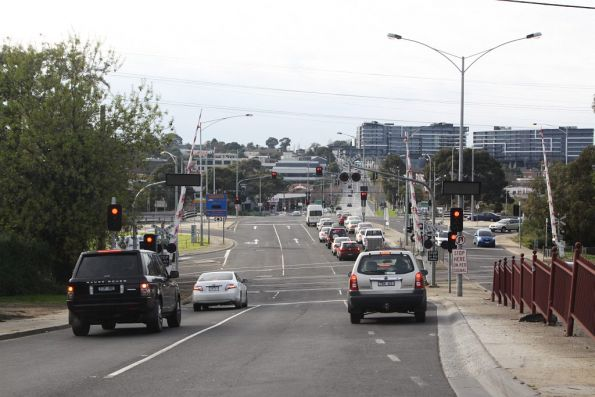 Driving east over the Toorak Road level crossing on the Glen Waverley line
