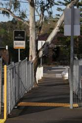 Federal Government 'Boom Gates for Rail Crossings' sign at an upgraded pedestrian crossing