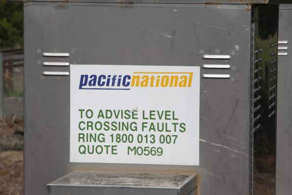 Pacific National branded level crossing identification sign