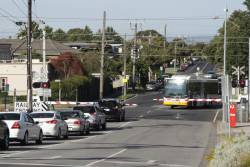 Traffic waits at the McDonald Street level crossing in Mordialloc