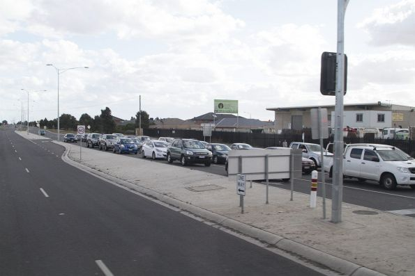 Northbound cars queue at the Mt Derrimut Road level crossing in Deer Park