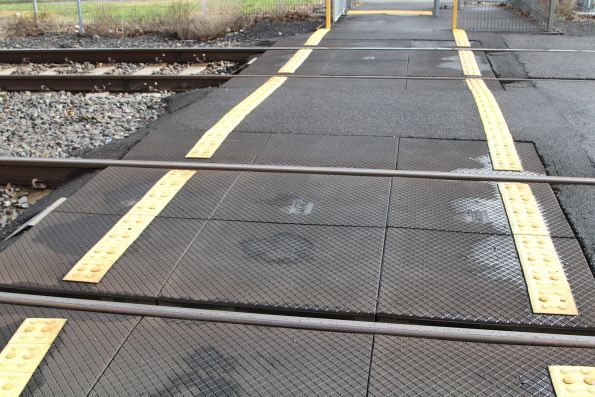 Rubber pedStrail panels at a pedestrian crossing
