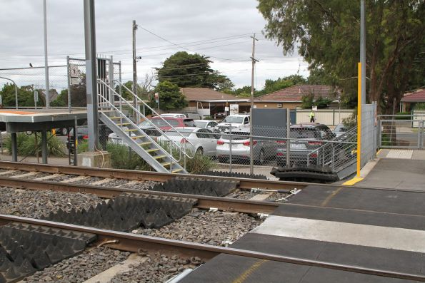 Anti-trespass panels installed beside the pedestrian crossing at Keilor Plains station