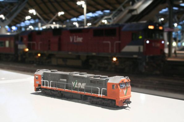 Buy my magic miracle cream - it takes off 100 tonnes and 20 years! (N scale N class locomotive in front of the prototype)