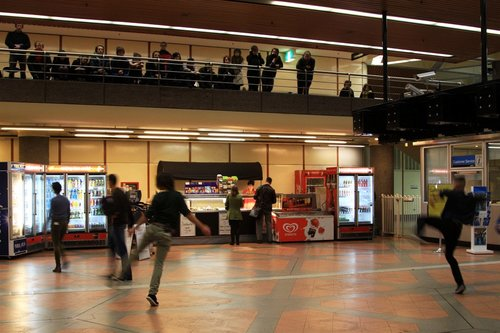 Dancers on the station concourse, the audience up above