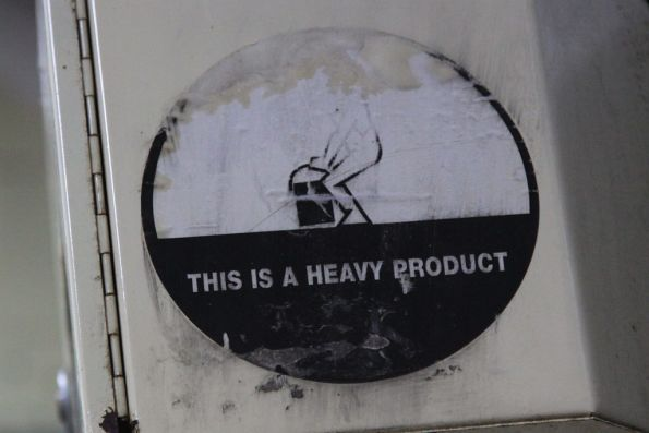 One of the 'This is a heavy product' stickers that covered the rail network a decade ago