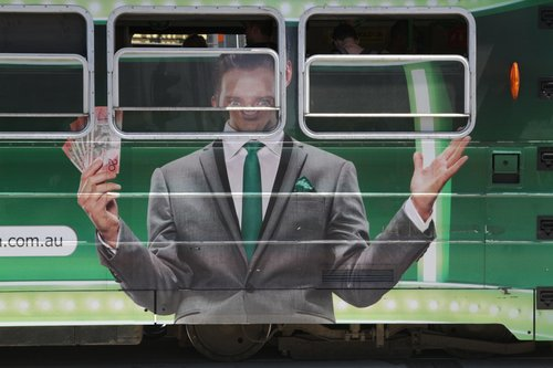 That is one creepy looking guy on the side of a tram!