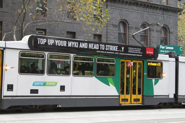 'Top up your myki and head to Strike...y' advertisement on the side of a Melbourne tram