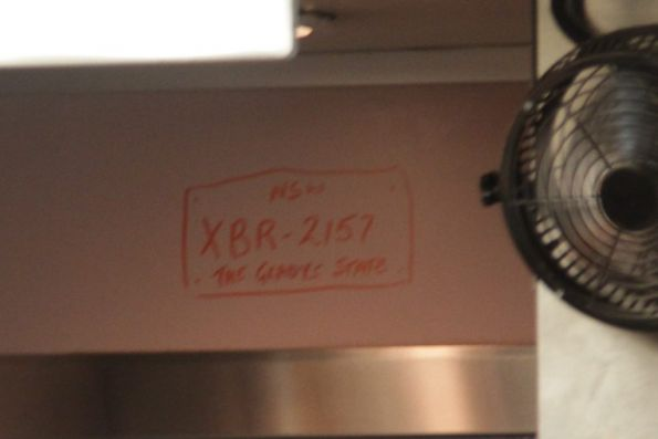 'NSW / The Gladys State' registration plate onboard XPT dining car XBR-2157
