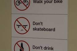 Frowny faced 'Don't skateboard' sign at Flinders Street Station