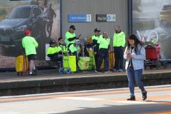 Pack of Australia Post posties wait for the next citybound train at North Melbourne