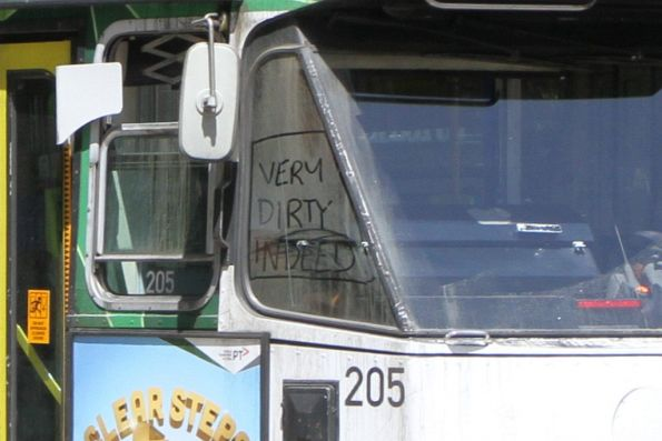 'Very dirty indeed' drawn in the window dust on tram Z3.205