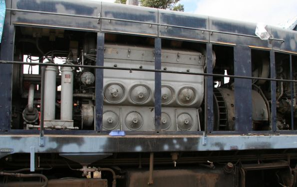 Engine and main generator inside the hood of T364