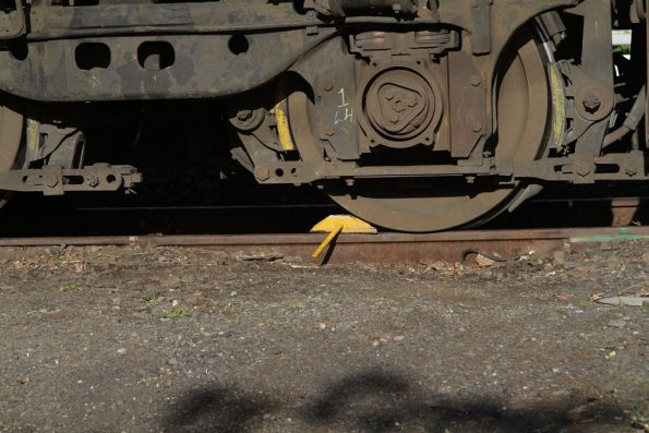 Timber chocks in place beneath a stabled locomotive