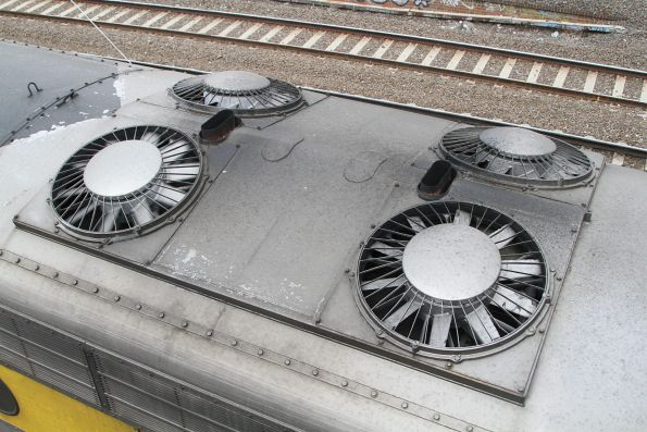 Four radiator fans and two exhaust stacks on the roof of S317
