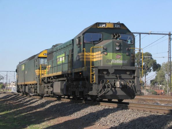 QR National locomotives X54 and G534 running light engine to CRT Altona