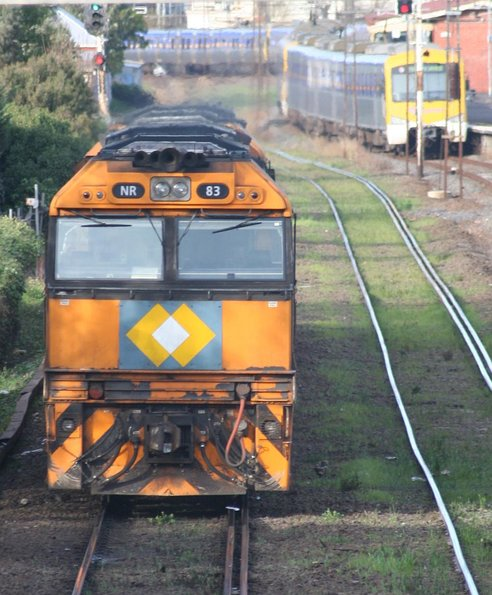 NR83, NR111, NR40 run towards Melbourne from Spotswood, with two sparks in the background