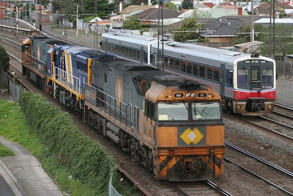 Two sprinters at Middle Footscray passing NR51, XRB562 and NRxx returning from Spotswood