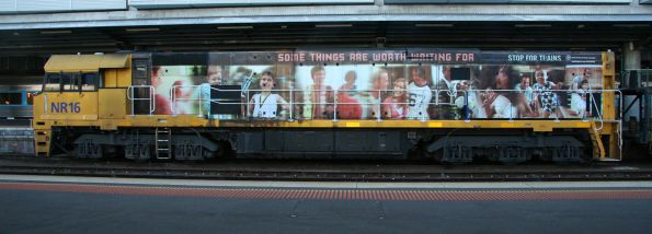 Pacific National locomotive NR16 in the South Australian government sponsored 'Some things are worth waiting for' livery
