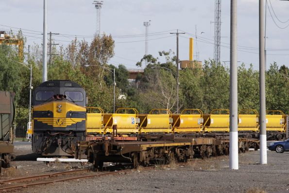 C501 idling away at the city end of North Dynon, miscellaneous BG wagons either side, refurbished ballast hoppers for Metro are behind
