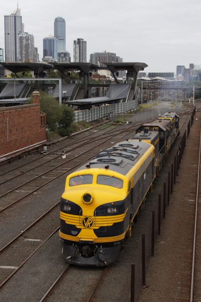 After changing ends at West Tower, B74 leads the consist past North Melbourne station