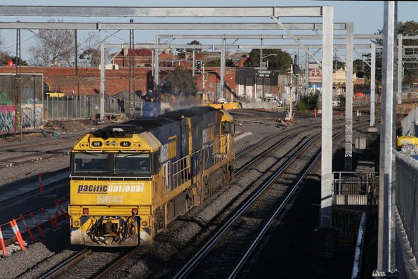 NR41 and classmate head through Middle Footscray light engine