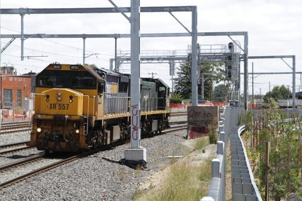 Broad gauged XR557 and XR552 head into town light engine at Middle Footscray